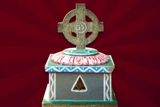 Aum symbol crucified on a Benedictine cross at Shantivanam