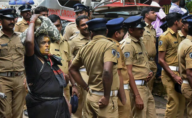 Police and female pilgrim at Sabarimala